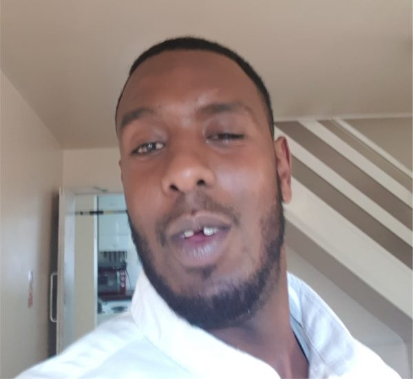 Murder suspect Abdi Ali shown without distinctive gold tooth